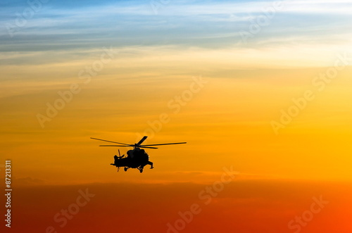 Poster Helicopter silhouette of the helicopter at sunset