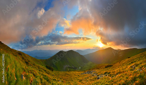 Foto op Canvas Koraal Sunset in summer mountains