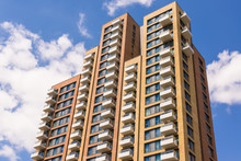 New Block Of Modern Apartments With Balconies And Blue Sky In Th