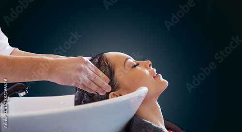 Photographie  happy young woman at hair salon