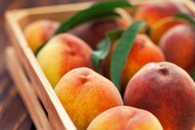 Fresh Peaches In A Wooden Basket