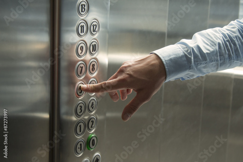 Finger pressing the button in the elevator Canvas Print