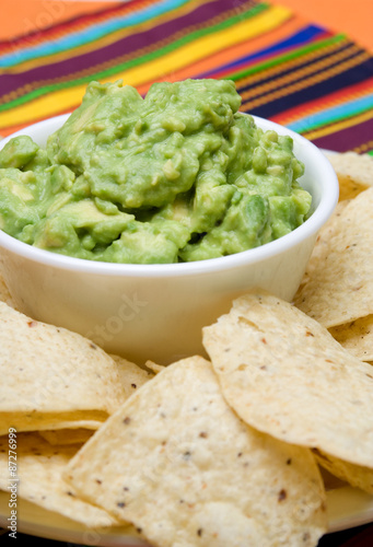 Fotografie, Obraz  Fresh Guacamole and Chips – A bowl of fresh guacamole