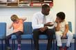 Teacher Solving Problem Between Two School Students