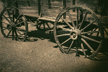 Old Wagon Wheel Symbolic Of Am...