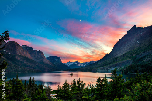 Beautiful colorful sunset over St. Mary Lake and wild goose isla