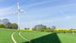 canvas print picture - Schatten einer Windkraftanlage auf dem Feld