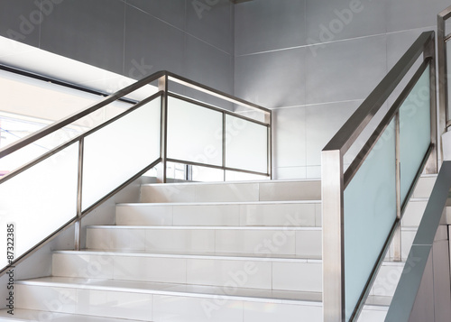 Tuinposter Trappen white stairs in modern office