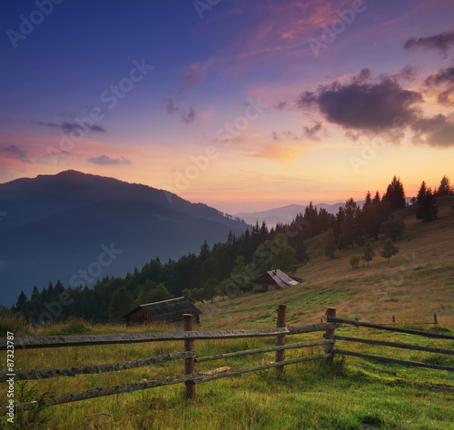 Photo Stands Lavender Fence in mountain valley. Agricultural landscape during sunrise.