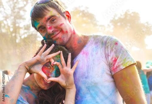 Foto op Plexiglas Bedehuis Happy couple in love on holi color festival