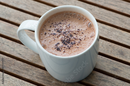 Foto op Canvas Chocolade Hot chocolate in a white cup on table