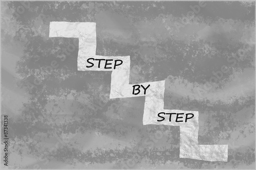 Fotografie, Obraz  Step by step written on stairs over abstract grey background