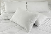 White Pillows On A Bed