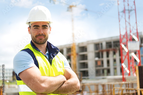 Tela Portrait of an attractive worker on a construction site