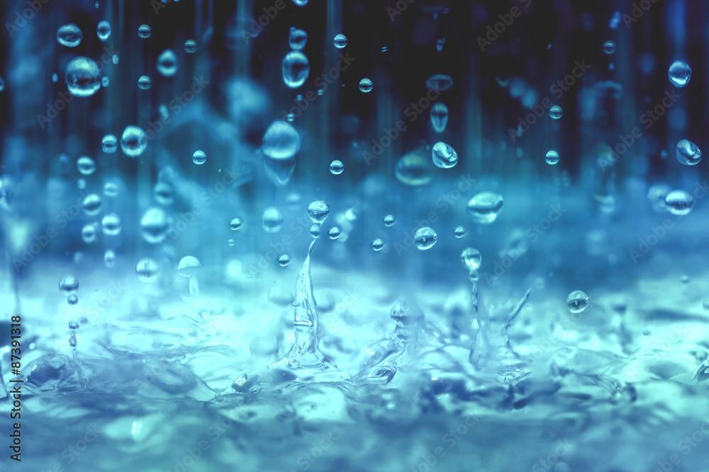 Fototapeta close up rain water drop falling to the floor in rainy season