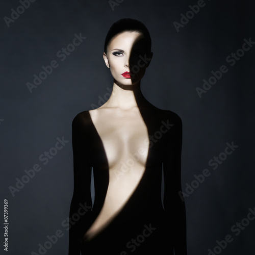 Poster womenART Gorgeous young lady with shadow on her body