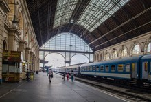 People Are Moving Through The Interior Of Budapest Keleti Train Station.