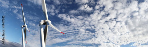 Fotografia  energy wind turbines on blue sky with clouds