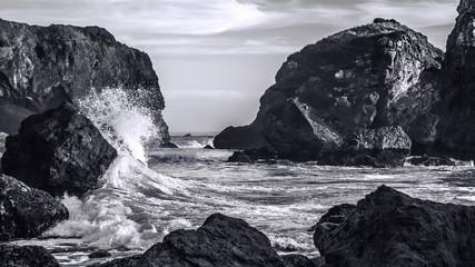 Panel SzklanyWaves Crashing on a Rocky Coast, Black and White