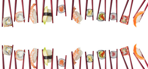 Fototapeta Sushi Many different sushi and rolls in chopsticks isolated on white background
