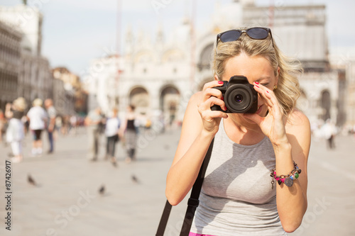 Foto  Tourist taking photos in Venice