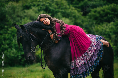 Beautiful gypsy in violet dress Canvas Print