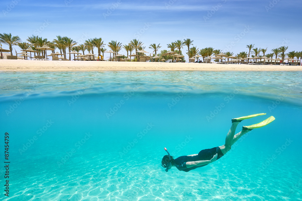 Fototapeta Young girl swims in the shallow bay, Marsa Alam Resort, Red Sea, Egypt