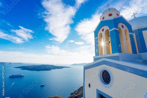 Poster Santorini Santorini beautiful church, sun and volcanic caldera with cruise ships, Greece