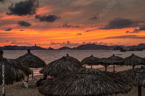 Fotografija  Sunset at Acapulco beach in Mexico