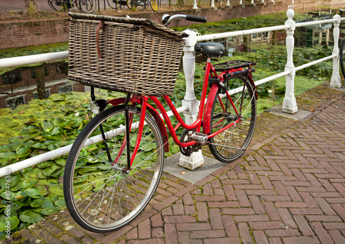 Red Bicycle Beside a Canal in Netherlands Canvas