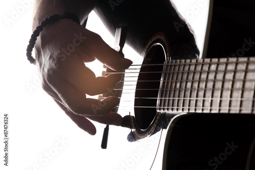 Acoustic guitar close-up with fingers playing it Poster