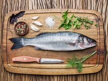 Seabass On A Wooden Board With...