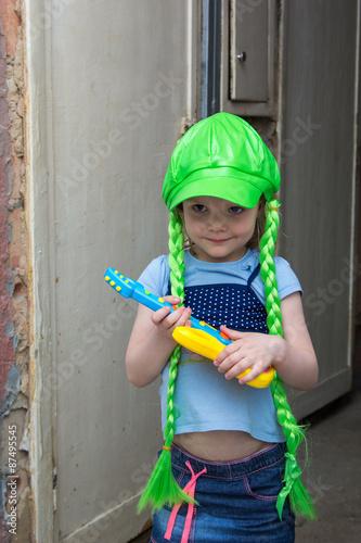 Fotografia, Obraz  little girl rock star in a wig with guitar