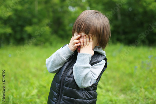 Valokuva  Portrait of crying 2 years child outdoors