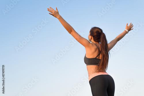 Spoed Foto op Canvas Gymnastiek Woman is back raising arms to the sky.