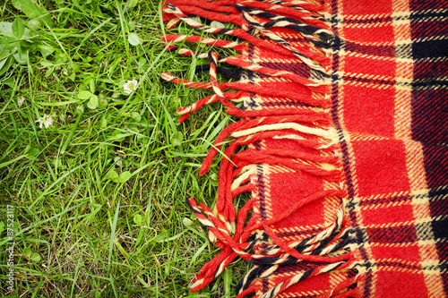 Aluminium Prints Picnic Checkered plaid for picnic on green grass. Picnic background