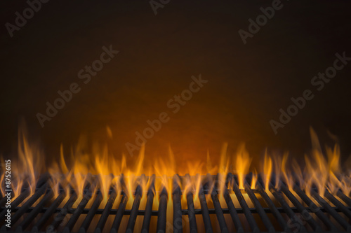 Door stickers Fire / Flame Flaming Hot Barbecue Grill and a Glowing Amber Background