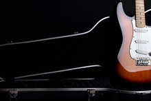 Electric Guitar In Guitar Case, On Black Background