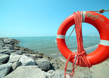Orange Jackets With Rope To Rescue Swimmers