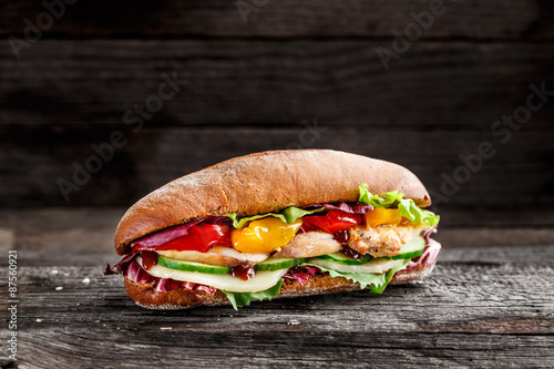 Spoed Foto op Canvas Snack Sandwich with chicken, cheese and vegetables