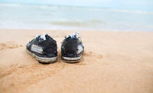 Canvas Shoes On The Beach