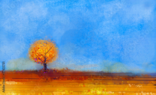 Abstract landscape, tree and field oil painting. Yellow,orange,red color and blue sky of falling season