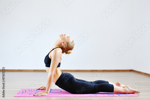 Woman in the cobra yoga pose Poster