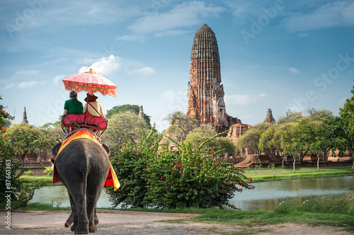 Canvas Print Tourists on an elephant ride tour of the ancient city Ayutaya ,thailand