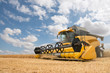 canvas print picture - close view of modern combine harvester in action.