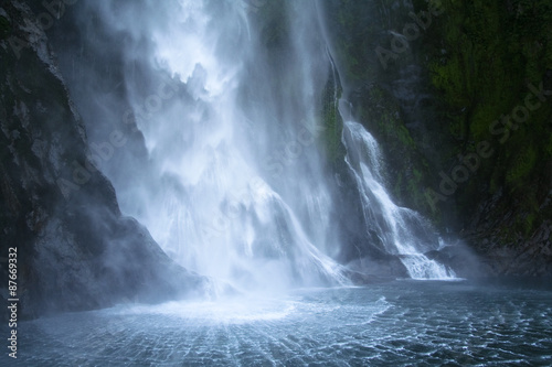 A waterfall in Milford sound , New Zealand