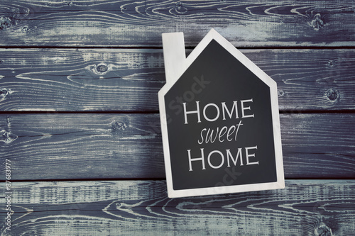 House shaped chalkboard on wooden background Canvas Print