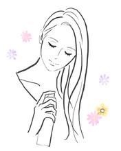 ヘアスプレーを髪にかける女性
