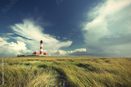 Fotobehang Vuurtoren famous Westerhever lighthouse at North Sea coast, Schleswig-Holstein, Germany, Europe, vintage filtered style