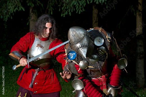 Fototapeta Two Knights Struggling For Survival in Dark Forest Closeup